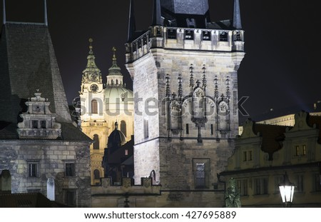 Mala Strana Bridge Tower at Charles Bridge in Prague, Czech Republic (Night view)      - stock photo