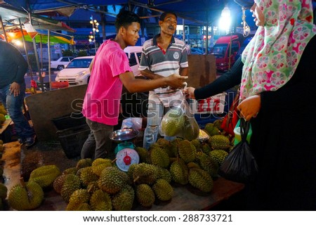 MALACCA-JUNE 8: Local durian at night market on June 8, 2013 in Malacca, Malaysia. The fruit is very popular in some Asian countries, especially in Malaysia and Thailand