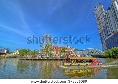 MALACCA, MALAYSIA - JAN 31, 2016 : Cruise tour boat sails on the Malacca River in Malacca. Rehabilitation of the Malacca River to develop river tourism started in July 2002