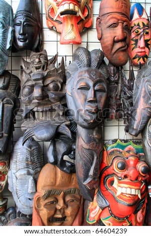 MALACCA, MALAYSIA - NOVEMBER 6: The ritual mask were displayed at Jonker Street on November 6, 2010 in Malacca. Local believes the mask gives  magical power and have been used for ceremonial purposes. - stock photo