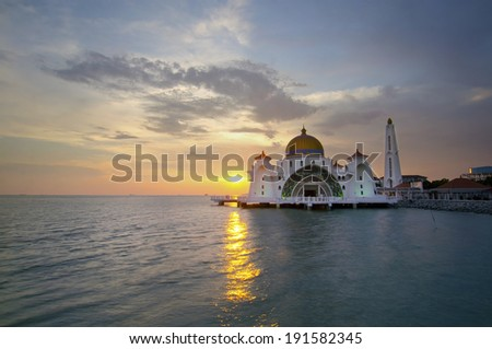 Malacca Straits Mosque (Masjid Selat Melaka) is a mosque located on Malacca Island near Malacca Town in Malacca state, Malaysia.Scenery during sunset - stock photo