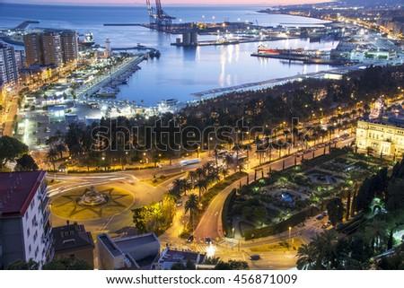 Malaga Port From Gibralfaro at Dusk with city lights - stock photo