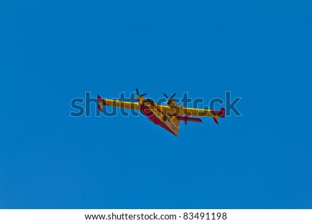 MALAGA, SPAIN - AUGUST 26: Canadair goes for water to put out fire on August 26, 2011 in Malaga, Spain
