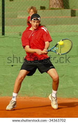MALAGA, SPAIN – JANUARY 11 : Albert Alcaraz in action during the final match of the 1st round of the Nike Junior Tennis Tour tournament at Malaga Tennis Club January 11, 2009 in Malaga, Spain. - stock photo