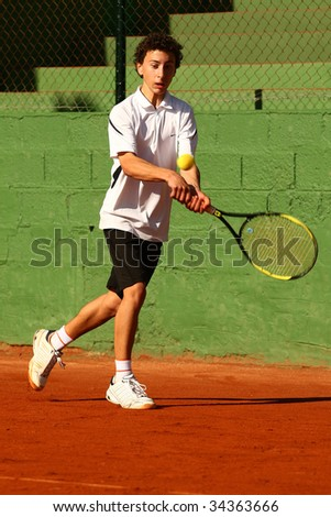 MALAGA, SPAIN – JANUARY 11 : Antonio Ayala in action during the final match of the 1st round of the Nike Junior Tennis Tour tournament at Malaga Tennis Club January 11, 2009 in Malaga, Spain. - stock photo