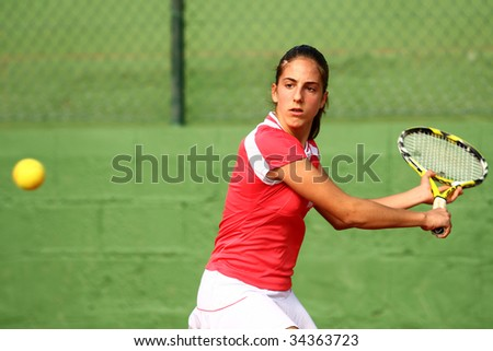 MALAGA, SPAIN – JANUARY 11 : Silvia Fuentes in action during the final match of the 1st round of the Nike Junior Tennis Tour tournament at Malaga Tennis Club January 11, 2009 in Malaga, Spain. - stock photo