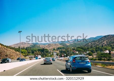Malaga, Spain - June 20, 2015: The movement of vehicles on freeway, motorway E-15 near  Malaga in Spain. - stock photo