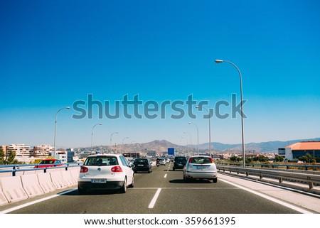 Malaga, Spain - June 20, 2015: The movement of vehicles on freeway, motorway MA-20 near  Malaga in Spain. - stock photo