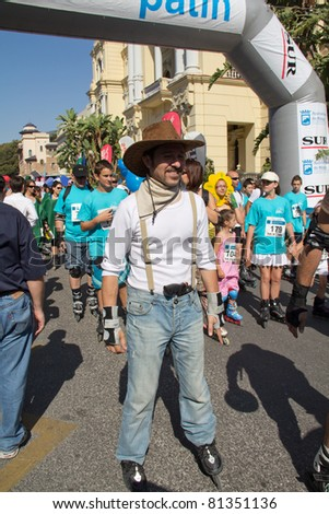MALAGA, SPAIN - JUNE 19: Unidentified skater disguised as cowboy start the 6th Skate Day race on June 19, 2011 in Malaga, Spain