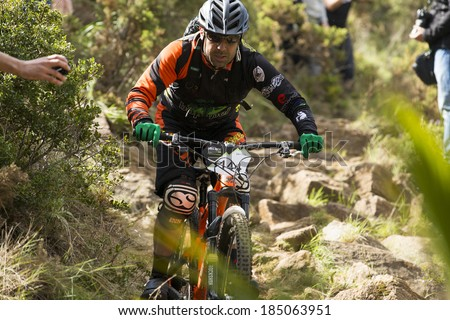 "MALAGA, SPAIN - MARCH 30: Unknown racer on the competition of the mountain bike ""BIG RIDE Open to Spain to Enduro"" on March 30, 2014 in Malaga, Spain"