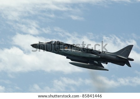 MALAGA, SPAIN - MAY 28: An Aircraft AV-8B Plus Harrier II makes a stationary flight during an airshow for the celebration of Armed Forces Day on May 28, 2011 at La Malaguetaon beach in Malaga, Spain. - stock photo