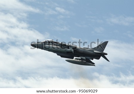 MALAGA (Spain) -MAY 28: Celebration of Armed Forces Day at the beach of La Malagueta. Aircraft AV-8B Plus Harrier II making a stationary flight on the airshow on 28 May 2011 in Malaga, Spain - stock photo