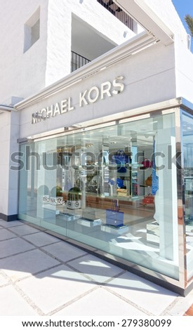 MALAGA, SPAIN - MAY 9:  Michael Kors shop pictured on May 9th, 2015 in Malaga, Spain.  Michael Kors is a fashion designer widely known for designing classic American sportswear for women.  - stock photo