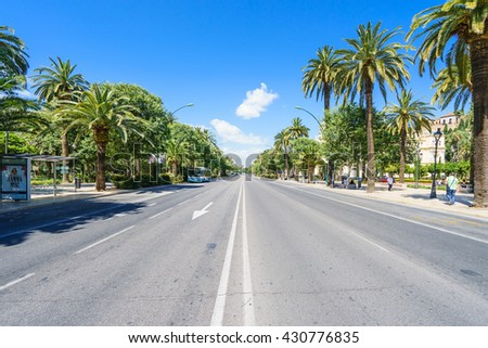 MALAGA,SPAIN - 28 MAY 2016: View on central park with palm trees in Malaga from road in sunlight - stock photo