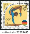 MALAGASY CIRCA 1992: A stamp printed by Malagasy, shows Women's gymnastics, circa 1992 - stock photo