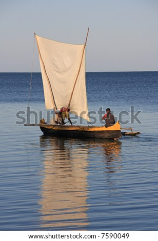 Malagasy fishermen and their outrigger canoes pirogue some of which had makeshift sails