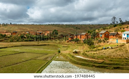Malagasy homes build along the hills of  the central highlands of Madagascar - stock photo