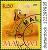 MALAWI - CIRCA 2008: A stamp printed in Malawi shows Pluto, circa 2008 - stock photo