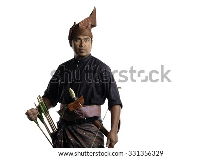 Malay archer with bow, arrows and keris in traditional malay warrior costume isolated on white background - stock photo