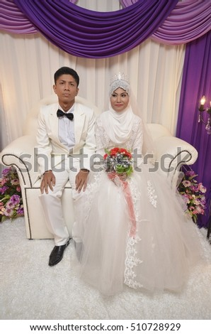 Malay couple bride wearing casual/modern style wedding dress ( soft focus at full resolution )
