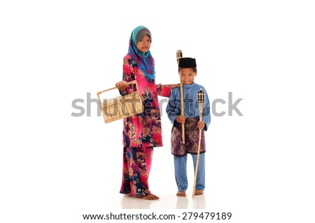 Malay girl with her brother in a festive celebration preparations  isolated over white background
