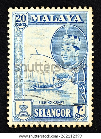 MALAYA - CIRCA 1957: Blue color postage stamp printed in Selangor (Federation of Malaya) with illustrative image of a fishing craft and portrait of Sultan Hisamuddin Alam Shah.  - stock photo