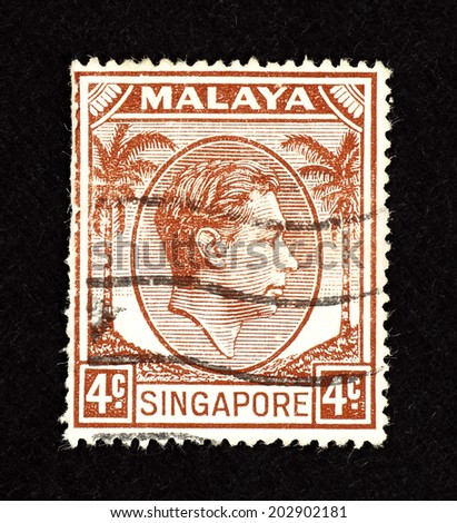 MALAYA - CIRCA 1938: Brown color postage stamp printed in Malaya Singapore with portrait image of King George VI.   - stock photo