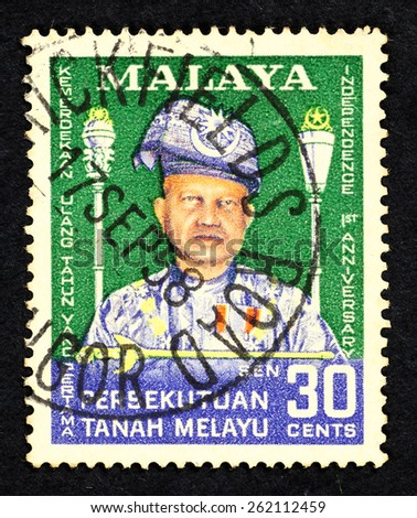 MALAYA - CIRCA 1958: Green color postage stamp printed in Federation of Malaya with portrait image of Malaysia first king, Tuanku Abdul Rahman, to commemorate the 1st Anniversary of independence. - stock photo
