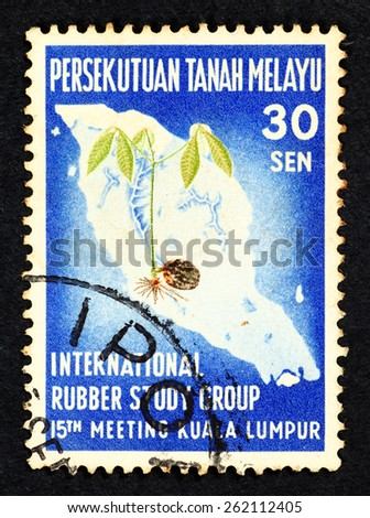 MALAYA - CIRCA 1960: Postage stamp printed in Federation of Malaya with image of a rubber tree seedling on Malaya map to commemorate international rubber study group 15th meeting in Kuala Lumpur. - stock photo