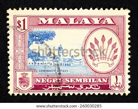 MALAYA - CIRCA 1957: Purple color postage stamp printed in Negeri Sembilan (Federation of Malaya) with illustrative image of government office building. - stock photo