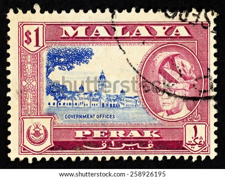 MALAYA - CIRCA 1957: Red color postage stamp printed in Perak (Federation of Malaya) with illustrative mage of government office building and portrait of Sultan Yussuf Izzuddin Shah. - stock photo