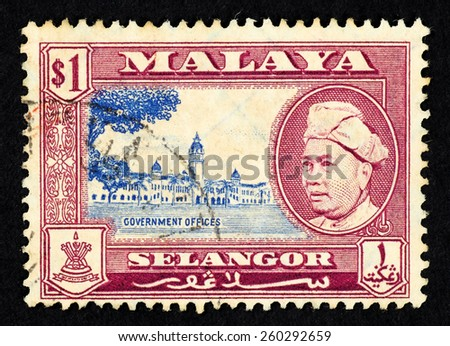 MALAYA - CIRCA 1957: Red color postage stamp printed in Selangor (Federation of Malaya) with illustrative image of government offices and portrait of Sultan Sir Hishamuddin Alam Shah Al-Haj.