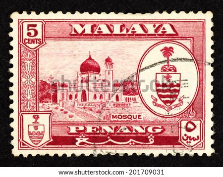 MALAYA - CIRCA 1957: Violet color postage stamp printed in Malaya Penang with images of an Islamic mosque.  - stock photo