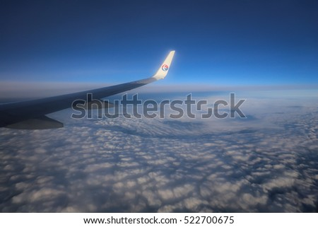 Malaysia Airlines - Oct 26, 2013 :aircraft wing Malaysia Airlines Flying in the Sky