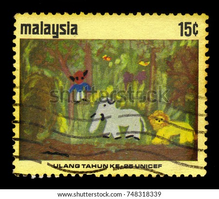 MALAYSIA - CIRCA 1971: A stamp printed in Malaysia shows childrens drawing: monkey, elephant and lion, 25th anniv. of UNICEF, circa 1971