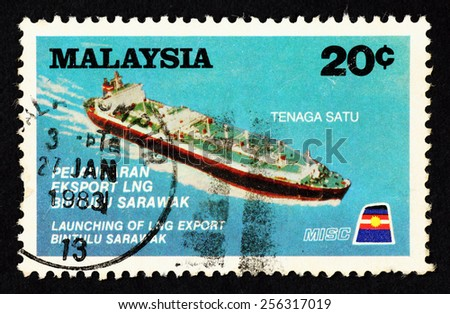 MALAYSIA - CIRCA 1982: Blue color postage stamp printed in Malaysia with image of the LPG Oil Tanker named Tenaga Satu, to commemorate the launching of LNG export in Bintulu, Sarawak. - stock photo