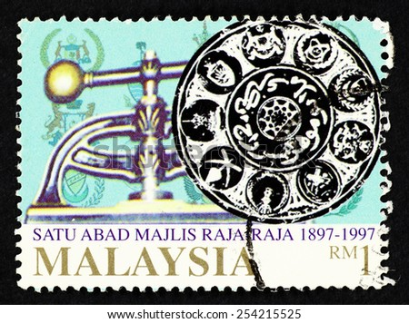 MALAYSIA - CIRCA 1997: Blue color postage stamp printed in Malaysia with image of the Royal Seal of the Malaysian Sultanate to commemorate the centennial of the Malaysia Royal Council. - stock photo