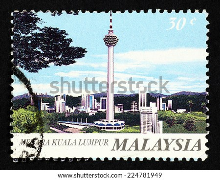 MALAYSIA - CIRCA 1995: Postage stamp printed in Malaysia with image of Kuala Lumpur Tower, to commemorate Malaysia's tallest communications tower. - stock photo