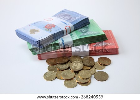 malaysia currency and coins on the white background - stock photo
