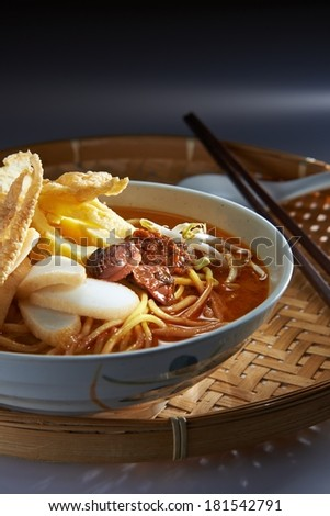 Malaysia Favorite Spicy Noodle Laksa With Fish Cake And Cockle - stock photo
