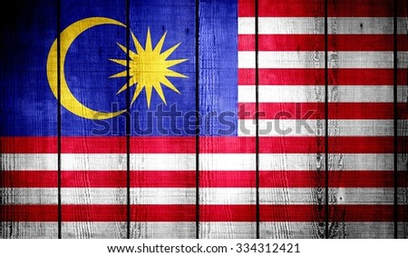 Malaysia Flag on old wood texture background - stock photo