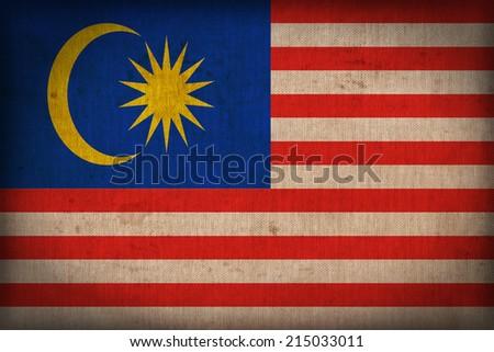 Malaysia flag pattern on the fabric texture ,retro vintage style - stock photo