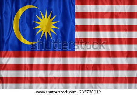 Malaysia flag pattern on the fabric texture , vintage style - stock photo