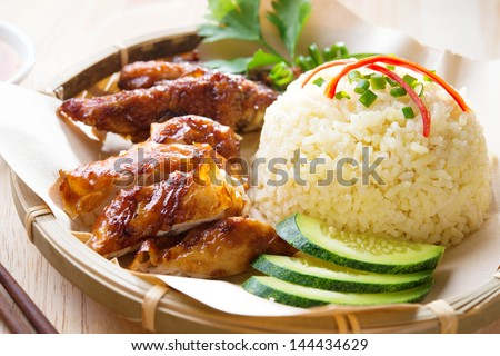 Malaysia grilled chicken rice. Asian style Hainan chicken rice close-up. Asian food. - stock photo