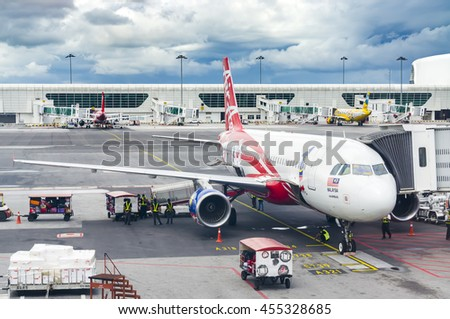 MALAYSIA-18 JULY 2016 - AirAsia Terminal in Kuala Lumpur Airport and storm clouds landscape. AirAsia is one of famous low cost airplanes at new Kuala Lumpur International Airport 2 terminal (KLIA 2).  - stock photo