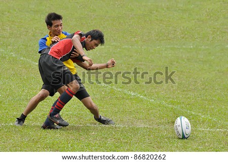 MALAYSIA - OCTOBER 15: Unidentified participants in action during a 10s Rugby Tournament Vice-Chancellor Cup at National Defense University Of Malaysia, Kuala Lumpur, Malaysia on October 15, 2011. - stock photo