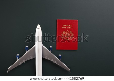 malaysia passport and toy plane
