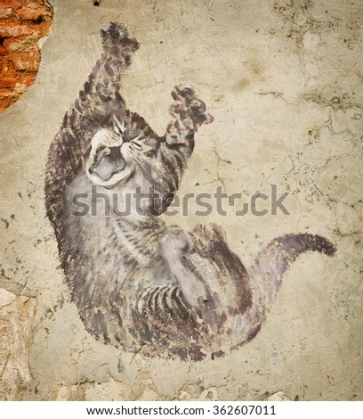 MALAYSIA, PENANG, GEORGETOWN - CIRCA JUL 2014: Fragment of a mural The Real Bruce Lee Would Never Do This - Funny cat