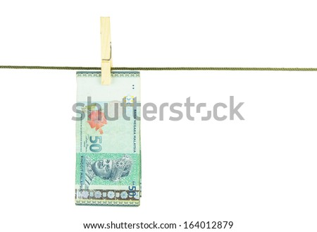 Malaysia 50 Ringgit MYR Bank Notes money hanging on a clothes line - stock photo