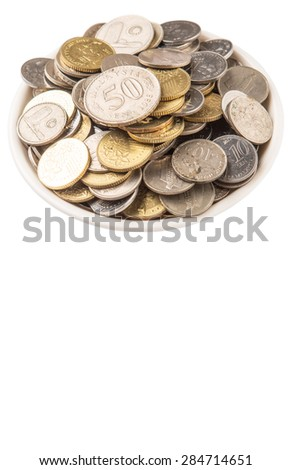 Malaysian coins in a white bowl over white background